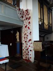 DTC'S Handmade Poppy Waterfall displayed at Holy Cross Church