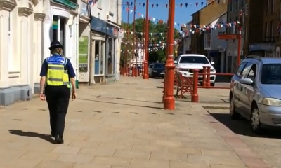 PCSO walking along the High Street